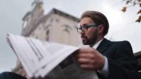 Person reading newspaper Miniatura de YouTube template